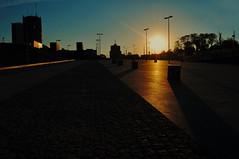 evening... (Eggii) Tags: lodz evening fabryczna sunset street city low angle sun sky light buildings