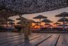 Danbo at sunset (Vagelis Pikoulas) Tags: sun sunset sunburst view landscape sea seascape beach canon 6d tokina 1628mm danbo summer 2017 july toy alykes drosias drosia sabbia bar umbrellas evoia