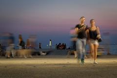 Summer night scene (giovdim) Tags: summer greece sea street night giovis long longexposure theater passing people motion fluid whitedress