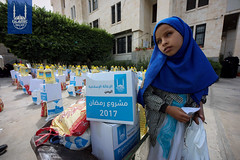 A young girl with the food parcel she received from Islamic Relief's food distribution in Yemen.