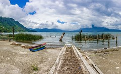 Lake Atitlán, Guatemala ((Jessica)) Tags: cayuco panorama atitlán leadinglines rainbow rx100v sonyrx100 travel guatemala santacatarinapalopó rx100 colorful lakeatitlán water lake volcano
