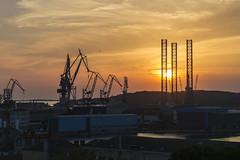 Pula sunset (amara01) Tags: sunset shipyard cranes croatia pula istria