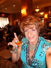 """A Big Peaty Slap In The Face"" (Laurette Victoria) Tags: scotch laphroaig milwaukee pfisterhotel woman laurette dress auburn necklace"
