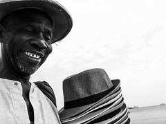 hat seller (akphotographs) Tags: beachseller streetphotography candid beach nicefrance nice06 france hat hats