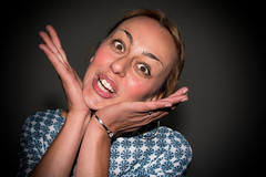 I am a flower. I think (Adult Grimaces series) (Phototravelography) Tags: adultgrimace grimaces italy portrait closeup detail expression expressive flower foolingaround fun funnyface lady person woman