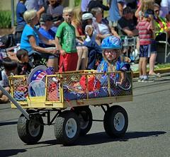 The Wagon Rider (swong95765) Tags: parade wagon kid crowd celebration transportation wheels cart