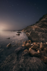 Embrace of Light (Manuel.Martin_72) Tags: italy elba darkmood darkness drama enchanting fairytale lightdrama magic coast rocks stones sea glow morning i