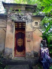 ubud_026 (OurTravelPics.com) Tags: ubud gate with closed doors dressed statue puri saren agung palace
