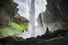 A walk behind a waterfall (elsvo) Tags: iceland selfportrait waterfall nature beautifulnature tinyhuman portrait colour redandgreen foss red dress reddress