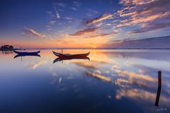 Ria de Aveiro - Sunrise (paulosilva3) Tags: sunrise ria de aveiro colors boat sun clouds water nature travel wild lake canon progrey filters portugal