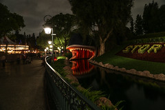 Whale of a Tale (KC Mike D.) Tags: storybookcanalboat whale monstro disney disneyland anaheim california fantasyland water reflection photography night railing line leading color park amusement ride teeth flowers floral carousel