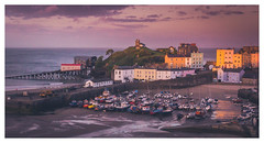 "Tenby Glow. (Ian Emerson ""I'm Back"") Tags: tenby holiday seaside seascape summer sunset evening glow magenta buildings lifeboat station sky clouds harbour pembrokeshire canon cliffs monument boats fishing hotels bb trawlers"