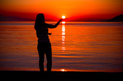 Hold the sun before it goes down (Vagelis Pikoulas) Tags: sunset sun porto germeno greece sea seascape landscape girl woman canon 6d tamron 70200mm vc view 2017 spring