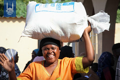 A women carries a food parcel in Zimbabwe. Islamic Relief USA's food distribution in Zimbabwe