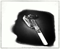 Day 176. (lizzieisdizzy) Tags: blackandwhite blackwhite black water whiteandblack white whiteblack monochrome mono monotone monochromatic tone tonal ice frozen colour red plate wooen stick lollypop melt melted h2o liquid ceramic food treat left forgotten