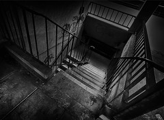 hiding in the shadows (amazingstoker) Tags: film noir view basingrad basingstoke amazingstoke grosvenor house hampshire monochrome high contrast stairwell grunge basing dutch angle tax office