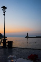 Watching the world go by. . . (Snipsnapper. May i thank anyone who takes the time) Tags: harbour chaniavenetianharbour crete water sunset sunsetting candle table lighthouse holiday 2017 bike bicycle