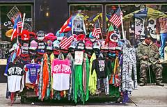 the veteran (albyn.davis) Tags: colorful people street timessquare nyc newyorkcity souvinirs flags city urban vivid vibrant