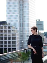 Skyline (Ben Gun) Tags: berlin skyline hightower dof bokeh unschärfe model female outdoor naturlalight balkon brüstung ballustrade dress black glasses hair portrait porträt posing looking