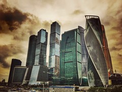 Moscow City cloudy (NO PHOTOGRAPHER) Tags: hochhaus gebäude cityscape skyline detail blackandwhite monochrome building outdoor architecture iphoneography iphonephotography exterier urban blue skycraper iphone 6s москва россия архитектура строительство река мост