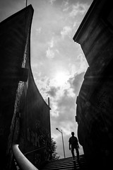the others (/ urban.fishing /) Tags: stairs backlight human architecture curve sun man walk sky clouds down silhouette contrast composition urban abstract bw black white monochrome scary subject