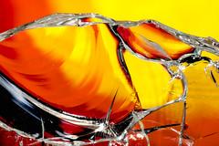 Shard (mdcaptures) Tags: macro glass red yellow broken macromondays orange closeup shard wine bottle white edge cut dangerous sharp samyang 85mm extension tube conchoidal fracture scallop beautiful lighting background abstract