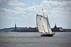 In the Harbor (tim.perdue) Tags: nyc new york city vacation big apple metropolis urban manhattan hudson river water cruise circle line boat harbor bay sailing ship sailboat watercraft ellis island liberty statue sky clouds