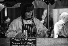 Biodynamic Beef (Nick Biswell) Tags: unitedkingdom london sony sonya100 sonydslra100 tamron tamron18270 tamrondt18270mmf3563 coventgarden stall chef cook cooking market niksoftware silverefexpro blackandwhite monochrome hat burger biodynamic beef organic woman smile smiling food fastfood