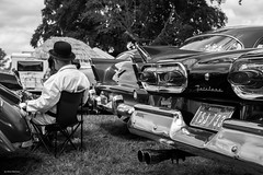 Fairlane (Silver Machine) Tags: vintagenostalgiafestival stockton wylyevalley fordfairlane man sitting bowlerhat deckchair chrome blackwhite bw mono monochrome fujifilm fujifilmxt10 fujinonxf35mmf2rwr