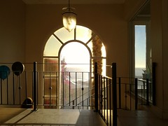 The end of the party (Cosmic Oxter) Tags: leaving goinghome balloons street staircase sunset light window