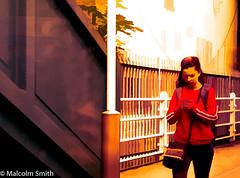 Texting (M C Smith) Tags: woman platform station pentax k5iis railings lamp fence footbridge red white brown