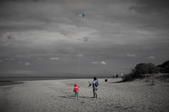 Mother, Daughter and a Kite (Hubert J. Farnsworth) Tags: mother doughter child mom parent kite flying sea beach sky