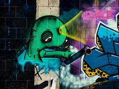 A Malignant Mole (Steve Taylor (Photography)) Tags: mole headlight grace pipe art cartoon graffiti mural streetart lamp green weird strange odd newzealand nz southisland canterbury christchurch cbd city shadow