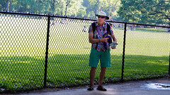 Tourist in Central Park (deepaqua) Tags: grass fence centralpark tourist sheepmeadow street nyc