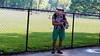 Tourist in Central Park (deepaqua) Tags: grass fence centralpark tourist sheepmeadow street nyc