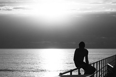 At he end of the day ... (Stelex) Tags: blackandwhite bw monochrome highcontrast silhouette man boy sitting fence ocean cloud sun reflection water adelaide glenelg sa australia portrait