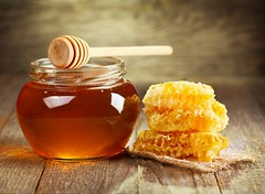 jar of honey with honeycomb (AnaghaSparrow) Tags: honey jar honeycomb stick yellow background healthy food sweet drizzler dipper wooden organic nobody wood liquid product pot natural table object gourmet delicious nutrition stilllife bowl russianfederation