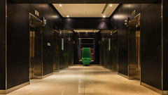 The green chair (BAN - photography) Tags: hotellobby lifts chair parkplaza lights timberpanelling d810