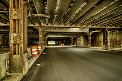 Under the tracks at Michigan Central Station, Detroit (TAC.Photography) Tags: iron structure road roadway bridge tunnel rr tracks railroad decay rust roadwork tomclarkphotographycom tomclark tacphotography michigancentral station