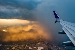 Landing ((Jessica)) Tags: sunset airplane windowseat texas houston rainclouds sony rx100 wing airport clouds sunser landing