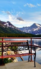 sunset view (ekelly80) Tags: montana glaciernationalpark nationalparkservice nps manyglacier june2017 roadtrip keisgoesusa optoutside findyourpark mountains rockymountains view scenery lake water swiftcurrentlake sunset sky night evening light seat bench snow snowy clouds