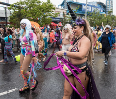 Marchers (UrbanphotoZ) Tags: mermaidparade coneyislandmermaidparade marchers women unicorns hairpieces streamers pasties colorful dayglo tiedye spectators coneyisland brooklyn newyorkcity newyork nyc ny