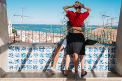 Lisbon, Portugal (f.d. walker) Tags: europe lisbon portugal couple love girlfriend boyfriend romance light sunlight shadow street streetphotography sun sky candidphotography candid color colorphotography city colors ocean sea viewpoint view