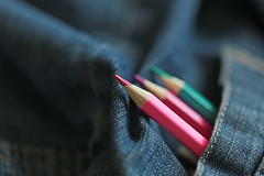 Wherever you go, be creative! (eleni m (busy remodeling house and garden)) Tags: pencils colours colouredpencils jeans indoor focus dof macro blue pink purple green pocket