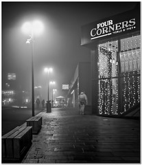 Out on the town (Hugh Stanton) Tags: fog mist lamp bench wet drizzle