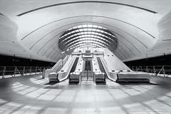 Heaven can wait (Bernhard Sitzwohl) Tags: london normanfoster architecture fineart highkey urban travel city tube underground canarywharf canarywharfstation tubestation bw uk isle dogs
