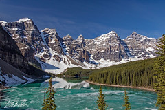 Moraine lake in the morning 2rwm (bodiver) Tags: canada canadianrockies landscape wideangle mountains lake evergreen trees snow