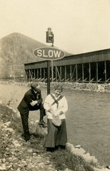 Slow! (Alan Mays) Tags: ephemera photographs photos foundphotos snapshots men women clothes clothing signs slow lanterns trafficsigns roadsigns railroadsigns streams rivers water mountains rocks buildings structures humor humorous funny amusing antique old vintage