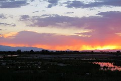Fireworks on the 4th (Patricia Henschen) Tags: alamosacolorado southriverroad alamosa colorado backroads rural sunset ranch mountains clouds reflection water