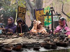 Praying Over The Burnt Lamps (Amna Yaseen) Tags: rituals faith 2015 saint sufi documentaryphotography femalephotographer devotee wish prayer oilburners lahore pakistan melachiraghan